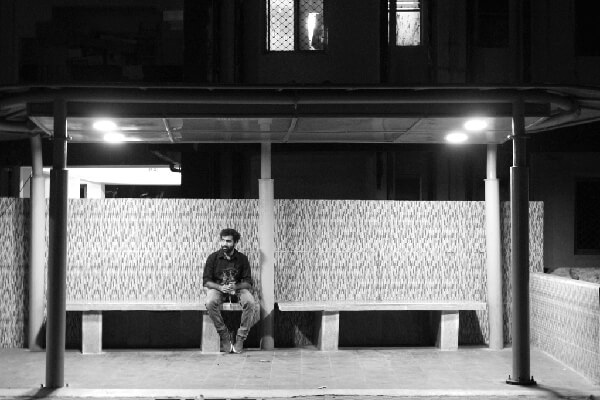 Subject sitting at a bus stop, waiting