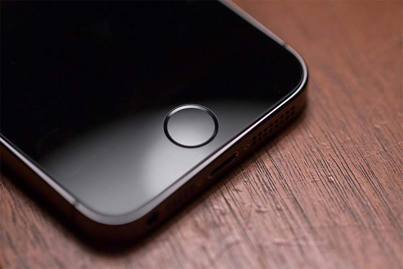An iPhone 5s home button, which includes a fingerprint scanner.