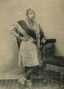 Fashion scene in India during British Raj.