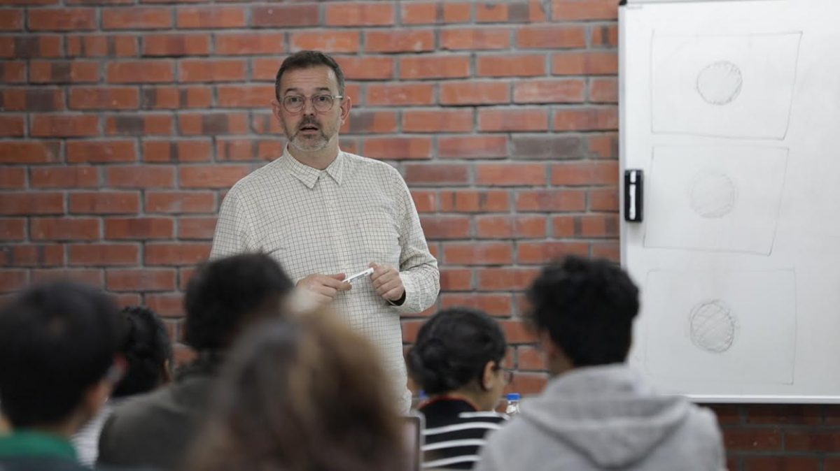 Dr Jake Abrams from Kingston University interacts with students of Communication Design.